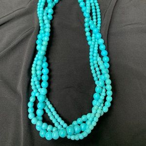 Turquoise colored multi strand bead necklace